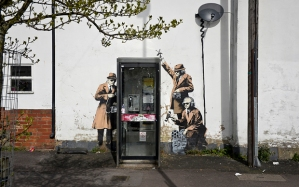 """File photo dated 14/04/14 of artwork by Banksy on the side of a house on Fairview Road adjacent to St. Anne's Terrace, Cheltenham, which has gone on the market for £210,000. PRESS ASSOCIATION Photo. Issue date: Friday January 8, 2016. Estate agents Peter Ball & Co describe the sale as """"a rare opportunity to acquire a Grade II listed, Victorian, three-bedroom end-terrace property with a genuine 'Banksy' on the gable wall. See PA story ARTS Banksy. Photo credit should read: Ben Birchall/PA Wire"""